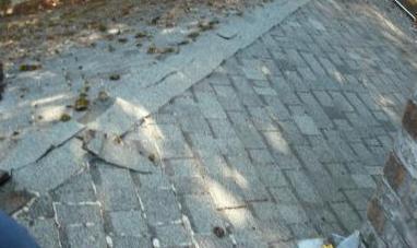 Improper Roof Installation Loose Sliding Shingles